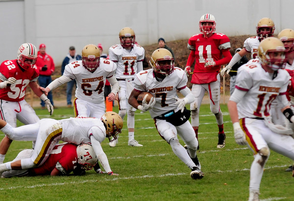 JIM VAIKNORAS/Staff photo Newburyport's Ronnie Mwai runs the ball during the Clipper's game at Amesbury Thursday.  Amesbury defeated Newburyport  22-17.