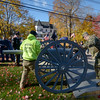 JIM VAIKNORAS/Staff photo Workers from Amesbury Towing roll a recently restored Spanish American War canon off their tow truck at the start of Amesbury's Veterans Day service at Amesbury Middle School Friday.