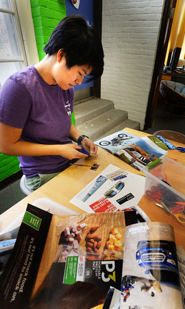 BRYAN EATON/Staff photo. Briana Mousley cuts out images and words from various magazines at the Newburyport Recreation Center on Wednesday afternoon. The program coordinator for Newburyport Youth Services was working with younsters making collages, hers being an inspirational one.