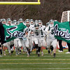 BRYAN EATON/Staff photo. The Pentucket Sachems burst onto the the Triton football field Thursday morning.
