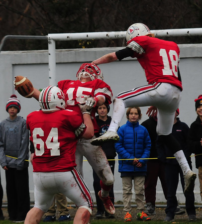 JIM VAIKNORAS/Staff photo  Amesbury's #15 Zach Prentiss is swarmed  by teammates Charles Wright and #18 Blake Bennett after a 2 point conversion against Newburyport at Amesbury Thursday.  Amesbury defeated Newburyport  22-17.