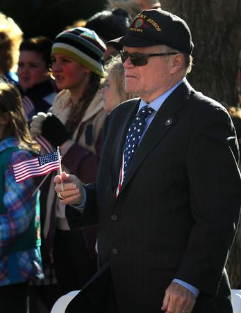 JIM VAIKNORAS/Staff photo Veteran Jack Bradshaw wave a small flag at the Veterans Day service at City Hall in Newburyport  Friday .