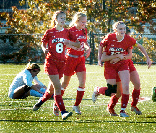 BRYAN EATON/Staff photo. Amesbury girls celebrate their goal in the first half tying the game with Matignon 1-1.