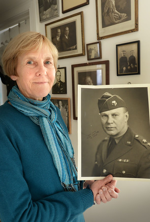 BRYAN EATON/Staff photo. Linda Harding of Newburyport with a photo of her grandfather Roger Weed Eckfeldt who served in the army in World War One and later was a major general in the Yankee Division and commander of Camp Edwards.
