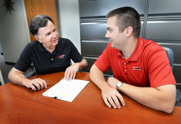 BRYAN EATON/Staff photo. Brian Zampell, right, with his father Jim.