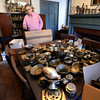 BRYAN EATON/Staff photo. An assortment of brass items cover a vintage dining room table.