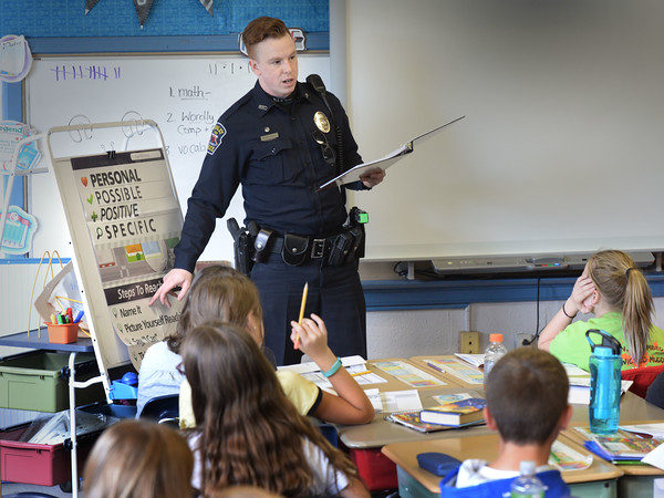 """BRYAN EATON/Staff photo. Rowley police officers Patrick McGettrick, pictured, and Sheri David speak to sixth-graders at the Pine Grove School in Rowley in a program called """"Too Good For Drugs"""" a school-based prevention program for kindergarten through grade 12. The program provides information about the negative consequences of drug use."""