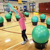 "BRYAN EATON/Staff photo. Emerson Hayden, 5, and other kindergartners at the Bresnahan School in Newburyport dance around and tap on excercise balls to the music ""What a Wonderful World."" They were in the program ""Drums Alive"" in physical education class which teaches them rhythmic patterns and eye-to-hand coordination."