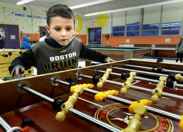 BRYAN EATON/Staff photo. Jack Ferreira, 7, looks intense as he spins the men of foosball Tuesday afternoon. He was at the Boys and Girls Club playing a couple games with his friend Max Fitzwater, 8.