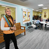 BRYAN EATON/Staff photo. Salisbury Council on Aging executive director Elizabeth Pettis shows off the upgrades at the Hilton Senior Center. The center has all new flooring and she's in front of new rooms added into the main area, one of which is the new thrift shop which opened up space for a reception area.