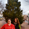 BRYAN EATON/Staff photo. Michelle Lamott, left, and Kate Curry have stepped up as co-chairs of the Amesbury Santa Parade committee. They appear in front of the Christmas tree in Market Square which will be lit after the parade this weekend.