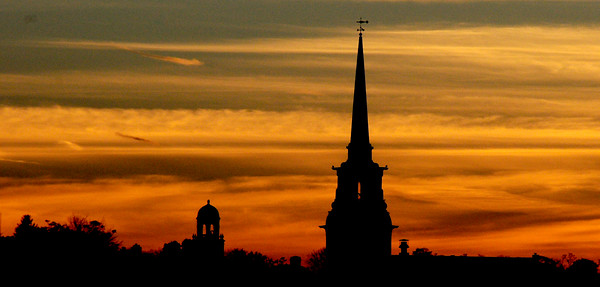 JIM VAIKNORAS/Staff photo The November sun sets behind the steeple at the Central Congregational in Newburyport with St Paul's church just to the left.