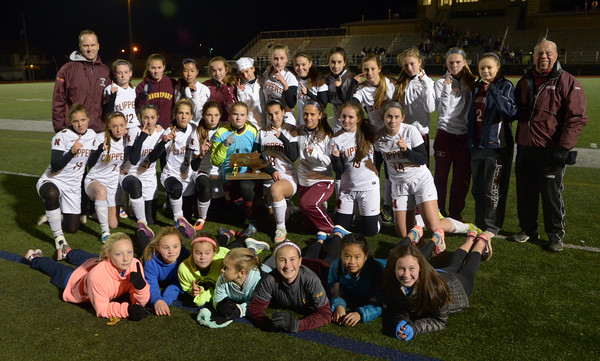 JIM VAIKNORAS/Staff photo Newburport girls soccer team pose with their North Sectional Trophy at the Manning Field in Lynn Saturday night.