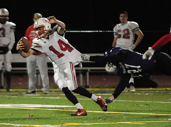 JIM VAIKNORAS/Staff photo Amesbury's Logan Burrill tries to brake a tackle during the Indian's game  at Shawsheen  Tech in Billerica Saturday night.