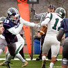 BRYAN EATON/Staff photo. Triton's Lewi L'Heureux strips the ball from Robert Porter but Pentucket recovered the ball.