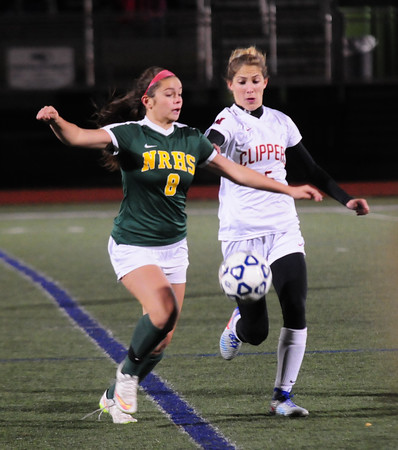 JIM VAIKNORAS/Staff photo North Reading's Alyssa Prusik fights for the ball with  Newburyport's Amelia  Kroschwitz at the Manning Field in Lynn Saturday night.