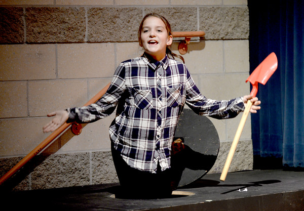 "BRYAN EATON/Staff photo. The Theater Workshop at Newbury Elementary School puts on ""Christmas in the Woods."" Allison Pugh as one of the Gophers comes out of her hole."