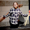 """BRYAN EATON/Staff photo. The Theater Workshop at Newbury Elementary School puts on """"Christmas in the Woods."""" Allison Pugh as one of the Gophers comes out of her hole."""