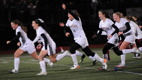 JIM VAIKNORAS/Staff photo Newburyport girl soccer team reacts after their victory against  North Reading at the Manning Field in Lynn Saturday night.