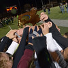 JIM VAIKNORAS/Staff photo Newburport girls soccer team hold their North Sectional Trophy at the Manning Field in Lynn Saturday night.