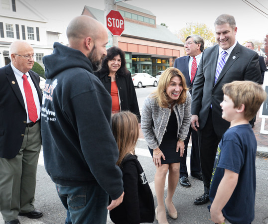 BRYAN EATON/Staff photo. Massachusett's Lt. Gov. Karyn Polito toured downtown Newburyport with city officials, one of several stops in the area including speaking at the Merrimack Valley Chamber of Commerce Dinner last night. Here she met with Joe Lauranzano of Newburyport and his children Libby, 5, and Briggs, 8, asking them what they dressed up as for Halloween.