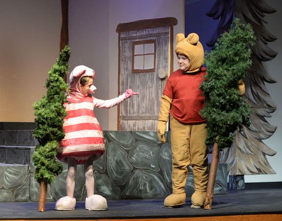 """BRYAN EATON/Staff photo. The Theater Workshop at Newbury Elementary School puts on """"Christmas in the Woods."""" Kaeden Carlson as """"Piglet"""" asks David Pugh as """"Pooh"""" why he brought a Christmas tree for the Rabbit as she already has one."""