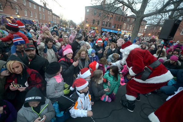 JIM VAIKNORAS/Staff photo Santa Claus greets kids at  the annual tree lighting in Market Square In Newburyport Sunday.