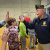 "BRYAN EATON/Staff photo. The Cashman School student council held a Veteran's Day Assembly on Thursday with several Viet Nam veterans in attendance. Bill Burnham and his fellow veterans got ""high fives"" from students as they left the assembly."