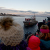 JIM VAIKNORAS/Staff photo The Coast Guard makes it's way up the Merrimack River towards the Newburyport Waterfront with Santa And Mrs Claus on board. They were heading to the annual tree lighting in Market Square.