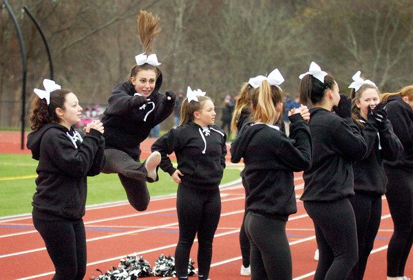 BRYAN EATON/Staff photo. Pentucket's cheerleaders perform during the Thanksgiving Day football game.