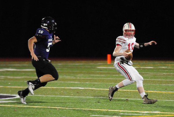JIM VAIKNORAS/Staff photo Amesbury's Blake Bennett scrambles on a pass play during the Indian's game  at Shawsheen  Tech in Billerica Saturday night.