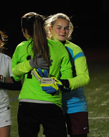 JIM VAIKNORAS/Staff photo Newburyport goalie Jen Stuart hugs  North Reading goalie Katarina Hassipis after their game at the Manning Field in Lynn Saturday night.