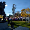 JIM VAIKNORAS/Staff photo The Doughboy statue stands above the crowd at the Amesbury's Veterans Day service at Amesbury Middle School Friday.