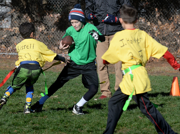 BRYAN EATON/Staff photo. Ducks running back Andrew Johnson makes an evasive move playing against the Seminoles in the Williams Bowl at Salisbury Elementary School on Wednesday. The pre-Thanksgiving Day game, formerly the Turkey Bowl, was named after retired gym teacher Rick Williams who started the annual tradition in 1971, the Ducks winning this game.