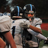 JIM VAIKNORAS/Staff photo Triton's Adam Rotberg hugs his teammate Gunner Gustafson near the end of the Viking's game against Hanover at  Rocky Marciano Stadium in Brockton Saturday.