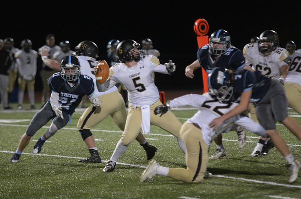 JIM VAIKNORAS/Staff photo   Bishop Fenwick's Cory Bright looks down field for a receiver l at Triton Friday.