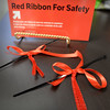 BRYAN EATON/Staff photo. Coastal Connections clients are among those making red ribbons to tie onto automobile antennas for the Amesbury Police Department's new Red Ribbon Campaign For Safety. Over 4,000 of the ribbons were made.