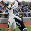BRYAN EATON/Staff photo. Pentucket's Robert Porter completes this pass for a touchdown as Triton's Lewi L'Heureux covers.