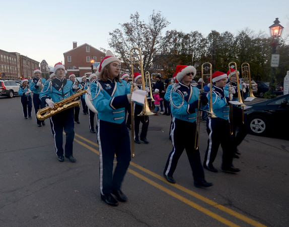 JIM VAIKNORAS/Staff photo The Triton High School band marches up Water Street in Newburyport on it's way  to the annual tree lighting in Market Square.