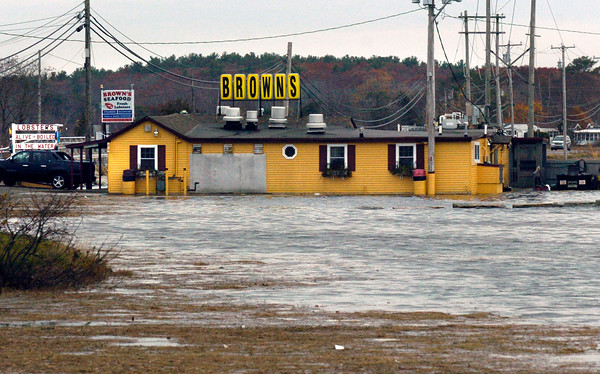BRYAN EATON/Staff photo. The King Tide, brought on by the Super Moon, didn't quite bring as much flooding as thought. The parking lot at Brown's Lobster Pound in Seabrook did get some flooding around noon time on Tuesday, but not much else was seen.