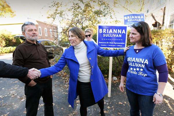 BRYAN EATON/Staff photo. Massachusetts attorney general Maura Healey, center, met with supporters of First Essex District candidate Brianna Sullivan outside Newburyport Ward 1 at People's United Methodist Church.