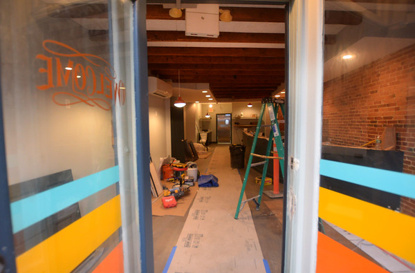 JIM VAIKNORAS/Staff photo Work continues on the Paddle Inn on State Street one of the new restaurants in Newburyport.