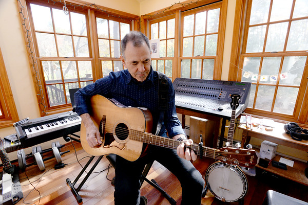 BRYAN EATON/Staff photo. EJ Ouellette is playing in Poverty's Music for Change.