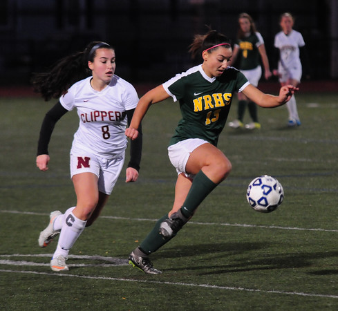 JIM VAIKNORAS/Staff photo Newburport'sSami Kelleher fights for the ball with North Reading's Giana Moscaritolo at the Manning Field in Lynn Saturday night.
