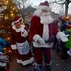 JIM VAIKNORAS/Staff photo Santa and Mrs Claus greet kids  at the annual tree lighting in Market Square In Newburyport Sunday.