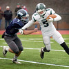BRYAN EATON/Staff photo. Triton's Christian O'Brien moves in on Pentucket's Stevie Johanson.