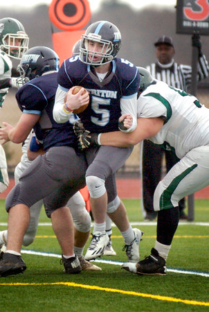 BRYAN EATON/Staff photo. Triton's Liam Spillane rushes into the end zone for the first touchdown of the game.