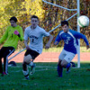 JIM VAIKNORAS/Staff photo  Pentucket's L Michael Armao chases down the ball against O'Bryant during their game  at Pentucket Friday.
