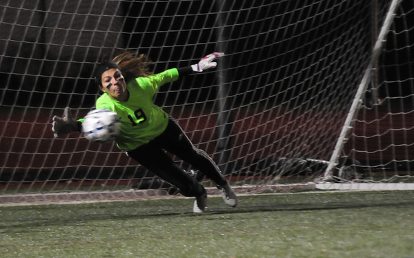 JIM VAIKNORAS/Staff photo North Reading goalie Katerina  Hassipis makes a save on a PK at the end of the Hornet loss to Newburyport at Manning Field in Lynn Saturday night.
