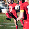 BRYAN EATON/Staff photo. Emma DiPietro kicks the ball away from her team's net in action with Matignon.